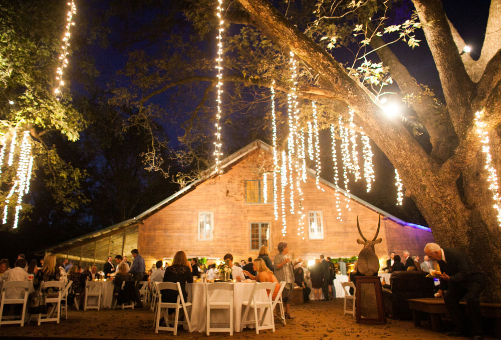 Wedding lighting ideas tent lighting goodwin events for How to hang string lights on trees