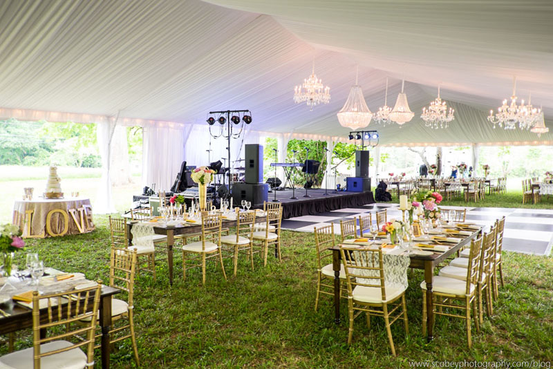 A huge collection of crystal chandeliers custom installed in a frame tent.  photo by Scobey