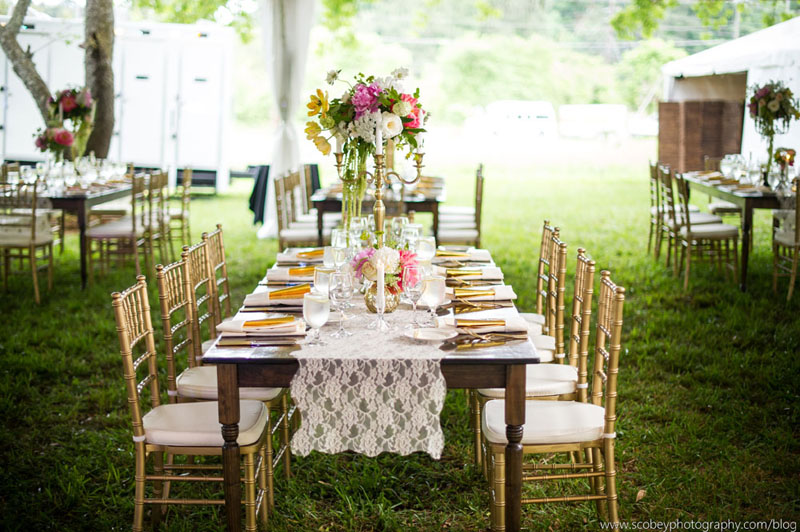 Gorgeous wedding tent with chandeliers lake oconee event rentals farm tables for rent in athens ga wedding chandeliers aloadofball Image collections