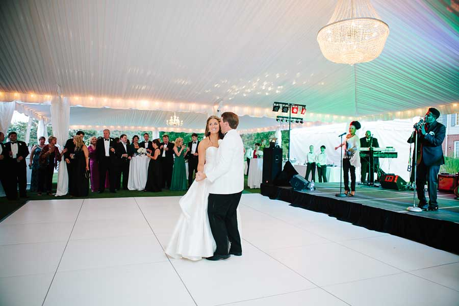 All white dance floor installed in a wedding tent