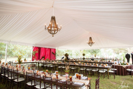 photos of a liner with chandeliers in tent