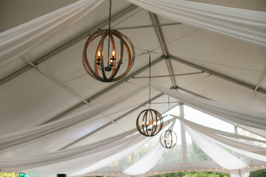 Chandeliers Hanging Inside A Wedding Tent Photos