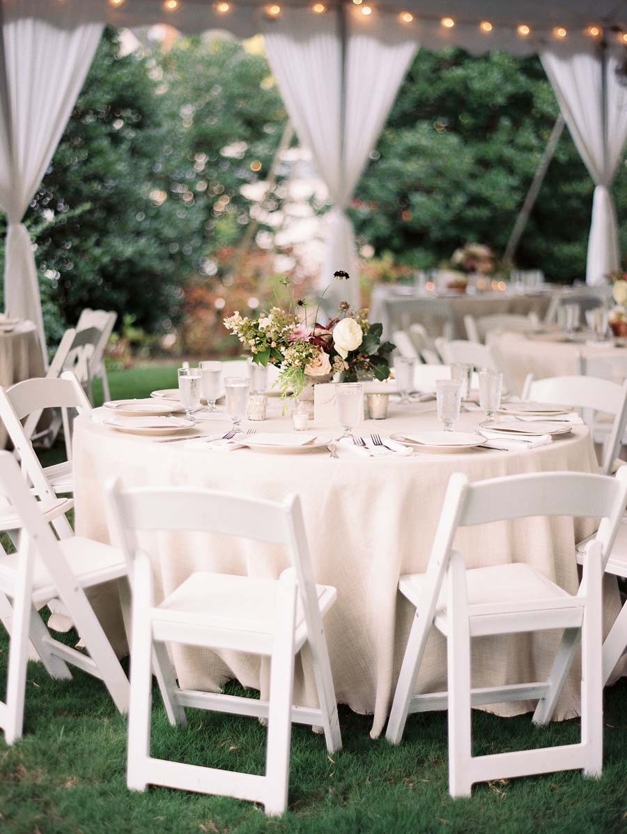 white chairs at athens wedding tent